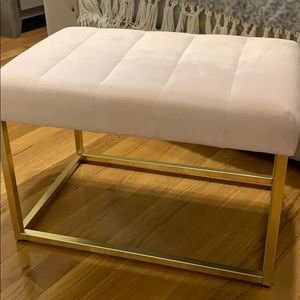 Light pink and gold bench